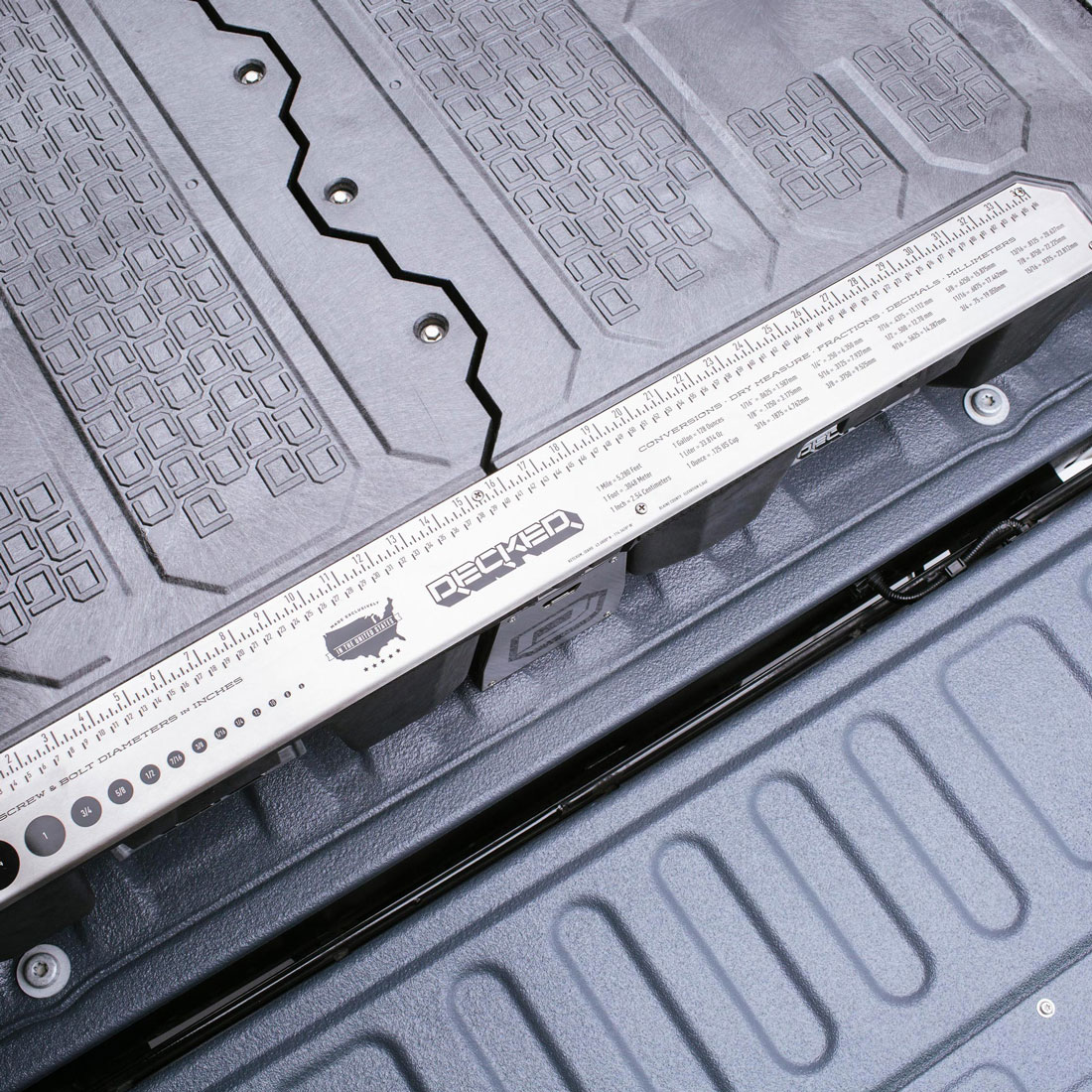 Pad-printed metal ruler doubles as deck edging detail