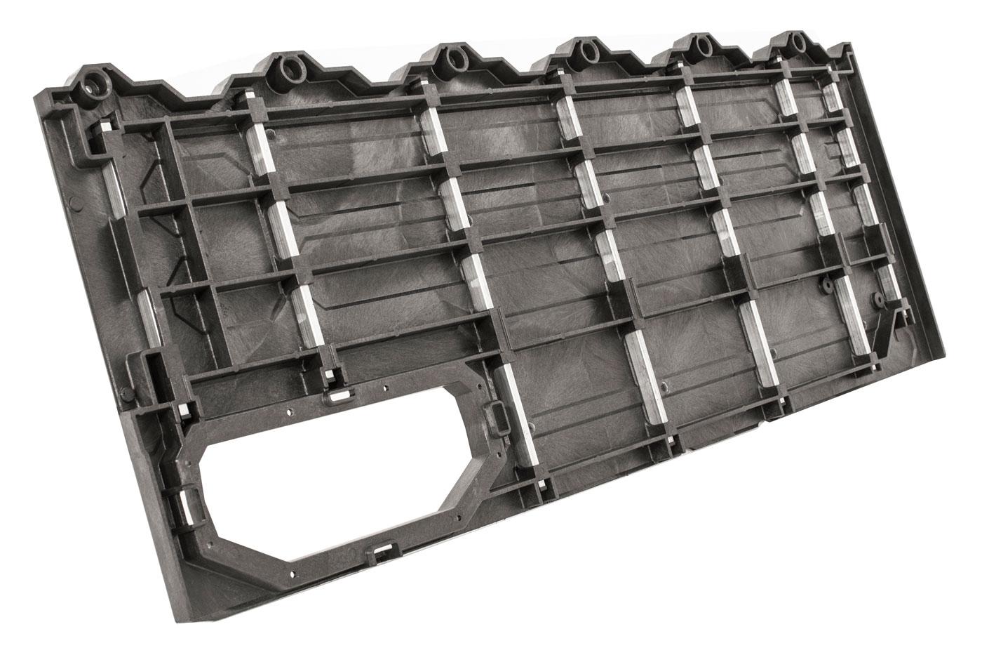 Deck panel back side showing innovative insert molded metal reinforcement rods