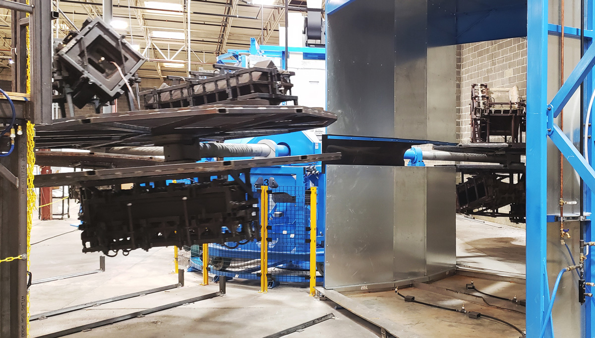 Rotational molding machine in factory.